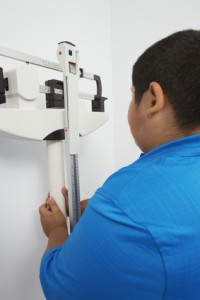 Obese Boy Measuring Weight